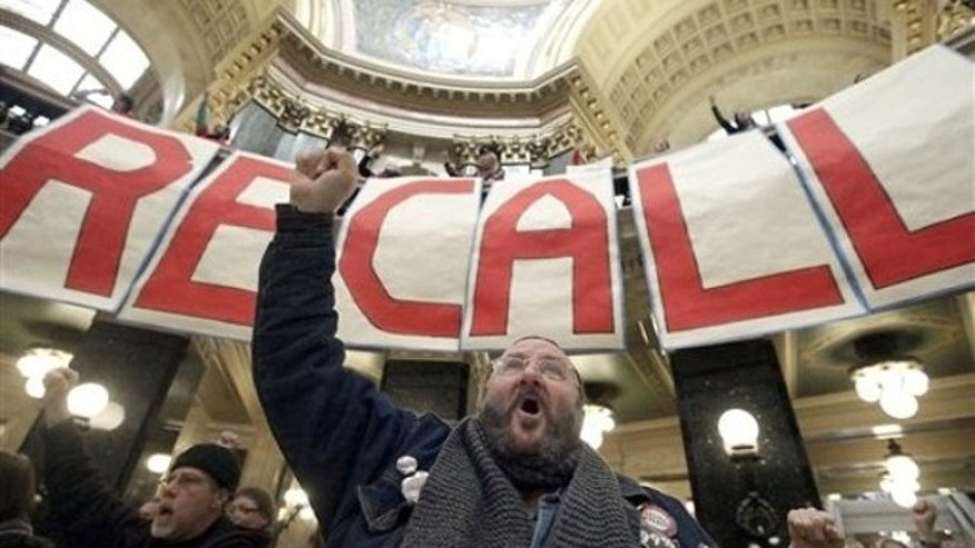 FILE: Jan. 17, 2012: Protesters including labor union supporters at a rally at the Wisconsin State Capitol in Madison, Wisc.