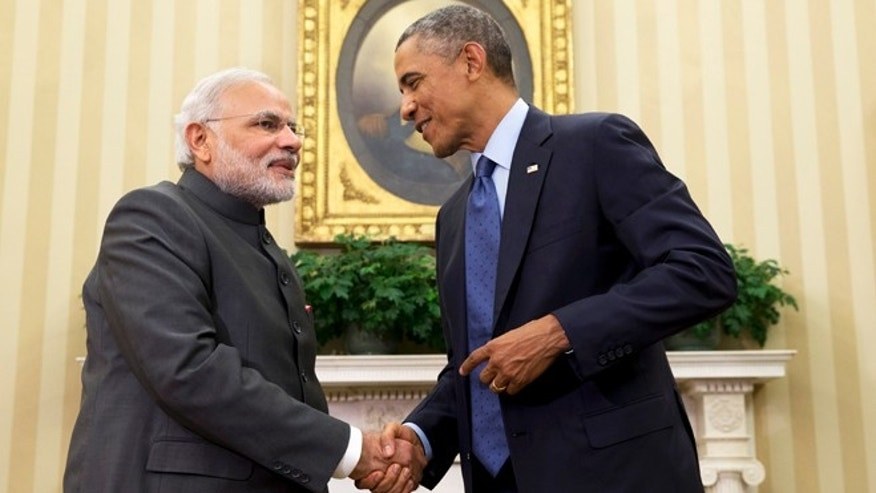 In this Tuesday, Sept. 30, 2014 photo, President Barack Obama shakes hands with Indian Prime Minister Narendra Modi in the Oval Office of the White House in Washington.
