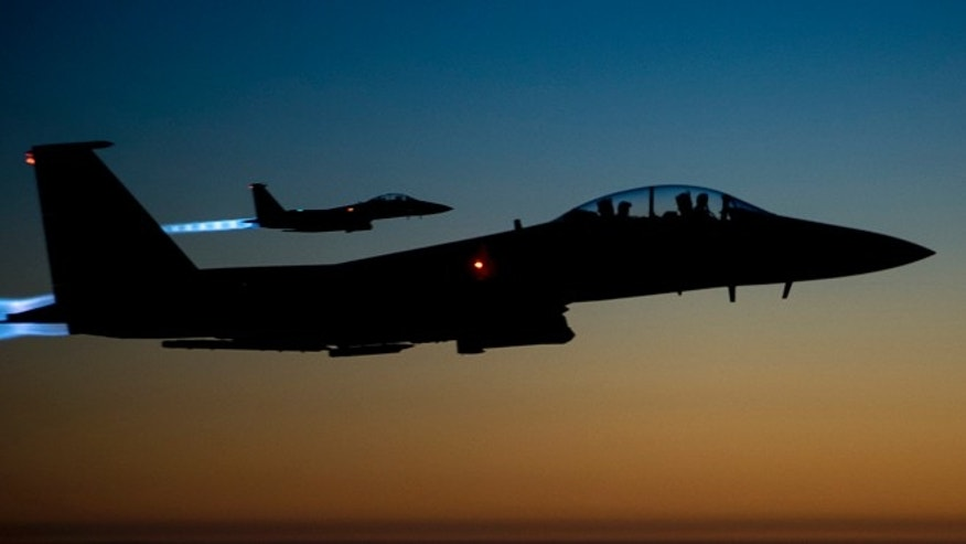 Sept. 23, 2014: In this photo released by the U.S. Air Force, a pair of U.S. F-15E Strike Eagle flies over northern Iraq, after conducting airstrikes in Syria. U.S.-led coalition warplanes bombed oil installations and other facilities in territory controlled by Islamic State militants in eastern Syria. (AP)