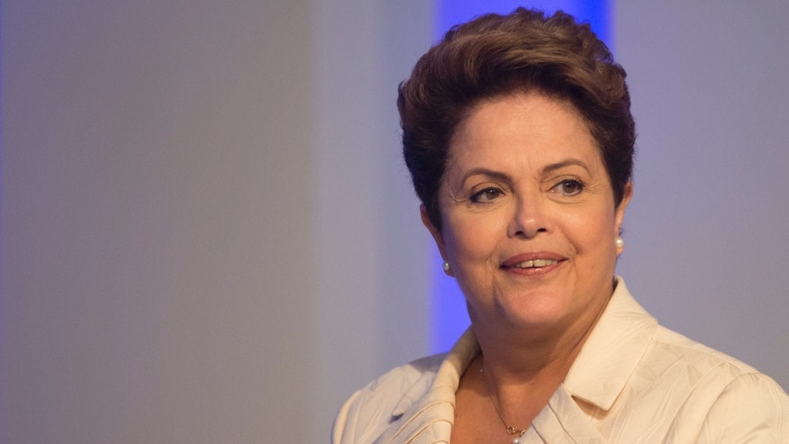 Brazil's President Dilma Rousseff, presidential candidate for re-election of the Workers Party (PT), attends a televised presidential debate in Rio de Janeiro, Brazil, Thursday, Oct. 2, 2014. Brazil will hold general elections on Oct. 5. (AP Photo/Felipe Dana)