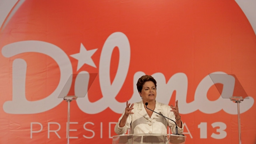 Brazil's President Dilma Rousseff, presidential candidate for re-election of the Workers Party, PT, talks about the results of the general elections during a press conference, in Brasilia, Brazil, Sunday, Oct. 5, 2014. Official results showed Sunday that President Dilma Rousseff will face challenger Aecio Neves in a second-round vote in Brazil's most unpredictable presidential election since the nation's return to democracy nearly three decades ago. (AP Photo/Eraldo Peres)