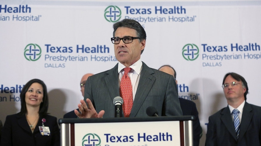 FILE- In the Oct. 1, 2014 file photo, Texas Gov. Rick Perry speaks at a news conference at Texas Health Presbyterian Hospital Dallas, in Dallas. The first diagnosed case of Ebola in the United States is a potential health crisis that gives Gov. Rick Perry another real-time leadership test. (AP Photo/LM Otero, File)