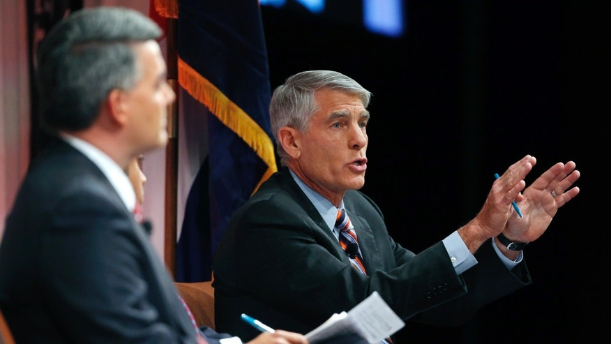 Incumbent U.S. Sen. Mark Udall, right, during a debate with U.S. Rep. Cory Gardner in Denver, on Oct. 6, 2014.