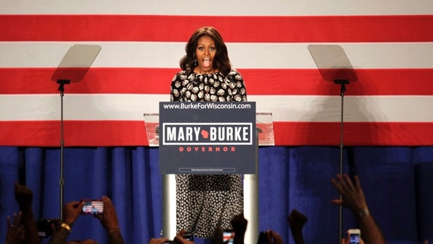 In this Sept. 29, 2014 photo, first lady Michelle Obama, speaks on behalf of  Wisconsin Democratic gubernatorial candidate Mary Burke at a campaign rally in Milwaukee.