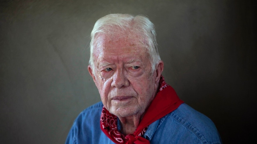 Former U.S. President Jimmy Carter pauses during an interview as he and his wife Rosalynn visit a Habitat for Humanity project in Leogane, Haiti.