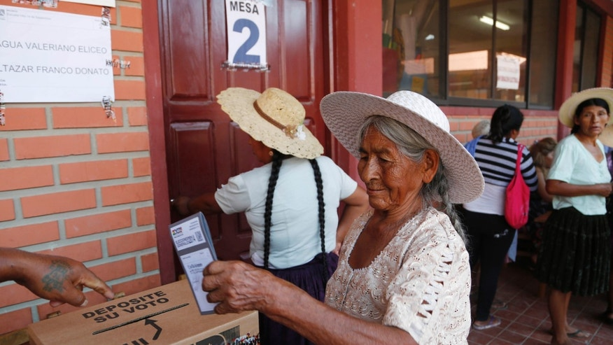 A woman casts her ballot at a polling station in Villa 14 de Septiembre, in the Chapare region, Bolivia, Sunday, Oct. 12, 2014. Bolivia is holding general and presidential elections Sunday with President Evo Morales appearing to be  headed to an unprecedented third term.(AP Photo/Juan Karita)