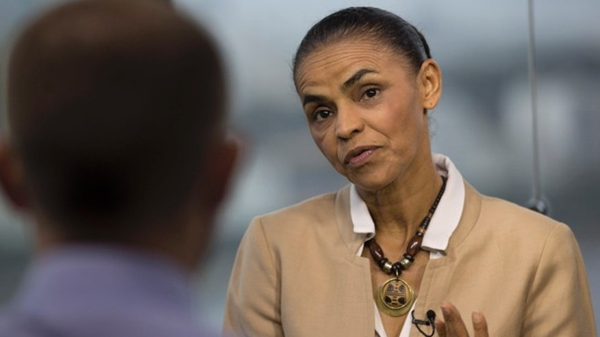 Marina Silva, presidential candidate of the Brazilian Socialist Party, speaks during an interview with AP in Rio de Janeiro, Brazil, Wednesday, Sept. 17, 2014. Silva was thrust into the Socialist Party's presidential nomination when its candidate of choice, Eduardo Campos, died in a plane crash last month. Heading into next months vote, Silva is tied in polls with incumbent President Dilma Rousseff. (AP Photo/Silvia Izquierdo)