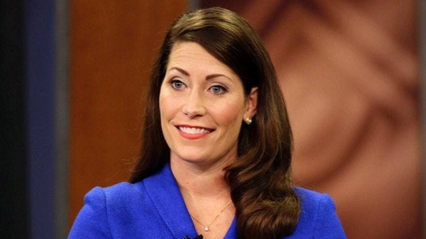 "In this Monday, Oct. 13, 2014 photo, Kentucky Secretary of State Alison Lundergan Grimes appears on ""Kentucky Tonight"" television broadcast live from KET studios in Lexington, Ky."