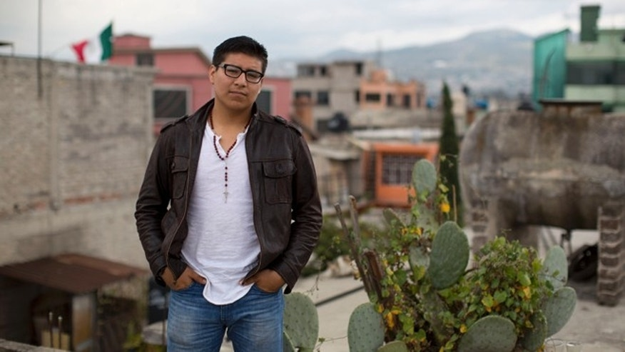 Dario Guerrero stands for a portrait on the rooftop of his grandparents' home in the outskirts of Mexico City.
