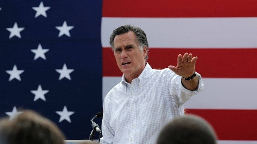 Mitt Romney, the former Republican presidential nominee, addresses a crowd of supporters while introducing New Hampshire Senate candidate Scott Brown at a farm in Stratham, N.H.