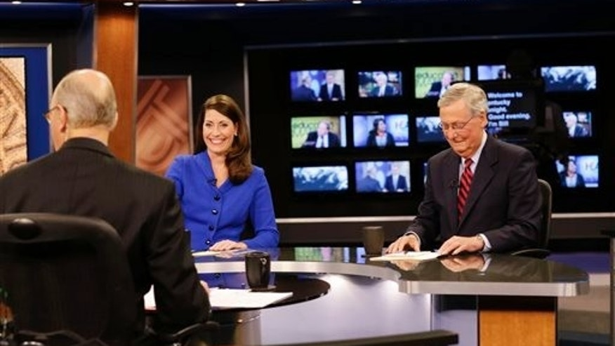 "Oct. 13, 2014: U.S. Senate Republican Minority Leader Mitch McConnell Ky.,  right, and  Democratic opponent, Kentucky Secretary of State Alison Lundergan Grimes, rehearse before their appearance on ""Kentucky Tonight"" in Lexington, Ky."
