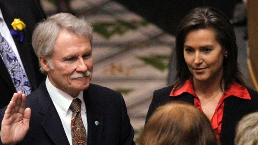 FILE: Jan. 10, 2011: Oregon Gov. John Kitzhaber, Democrat, is sworn in with financee Cylvia Hayes at his side. Salem, Oregon.