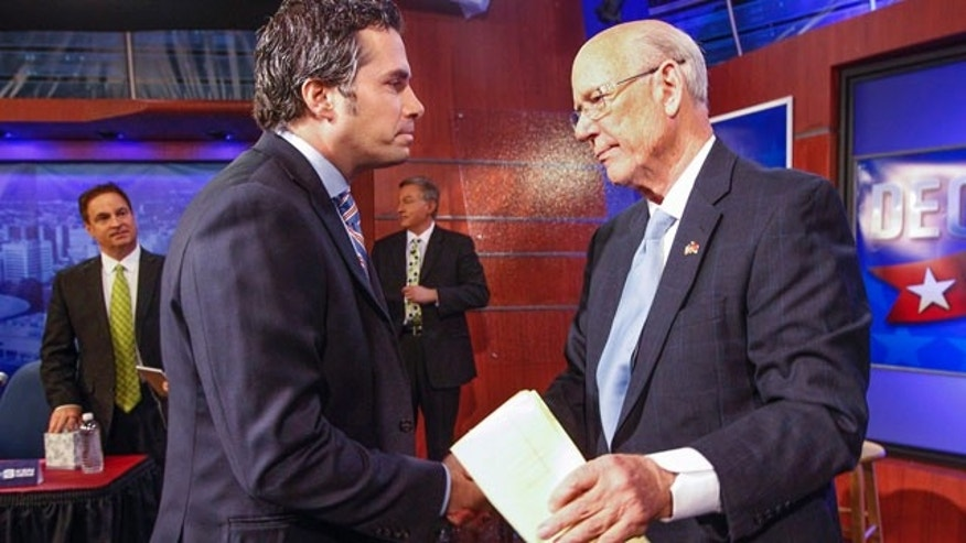 October 15, 2014: Independent candidate Greg Orman, left, shakes hands with Sen. Pat Roberts, R-Kan., following their debate in Wichita. (AP Photo/The Wichita Eagle, Fernando Salazar)