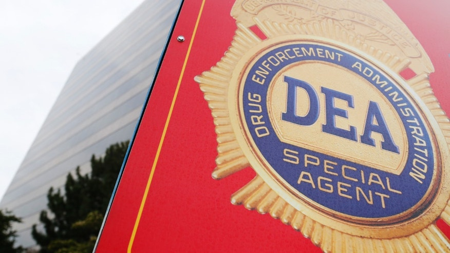 A sign with a DEA badge marks the entrance to the U.S. Drug Enforcement Administration Museum in Arlington, Virginia.