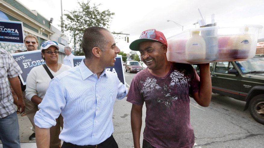 Jorge Elorza, Democratic candidate for mayor of Providence, R.I., front left, greets worker Cayetano Cepeda.