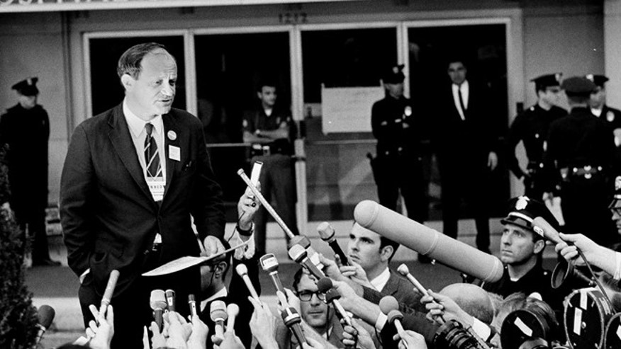 "June 5, 1968: Frank Mankiewicz, Sen. Robert F. Kennedy's press secretary, tells a news conference outside Good Samaritan hospital in Los Angeles, that Kennedy emerged from three hours of surgery in ""extremely critical condition."""