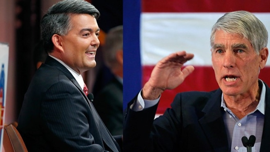 Republican challenger U.S. Rep. Cory Gardner (left) and U.S. Sen. Mark Udall, D-Colo., (right).
