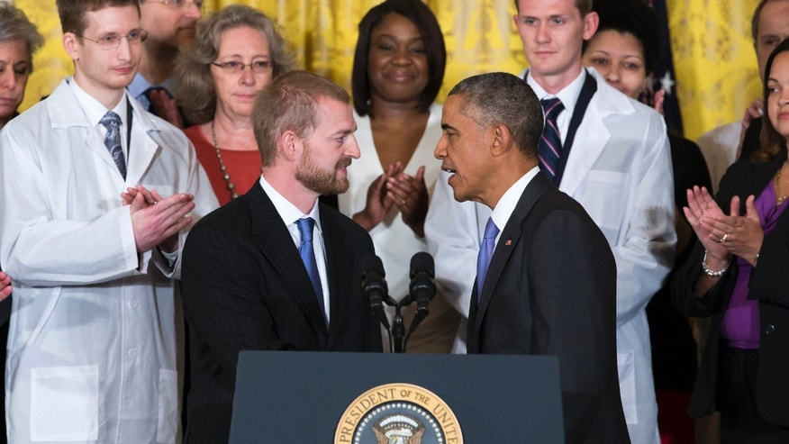 Oct. 29, 2014: President Barack Obama shakes hands with Ebola survivor Dr. Kent Brantly during an event with American health care workers fighting the Ebola virus.