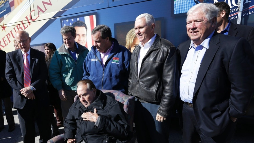 Oct. 31, 2014: Former Sen. Bob Dole, R-Kan., seated, is backed by Sen. Pat Roberts, R-Kan., from left, Gov. Sam Brownback, New Jersey Gov. Chris Christie, Indiana Gov. Mike Pence and former Mississippi Gov. Haley Barbour during a campaign stop in Kansas City, Kan.