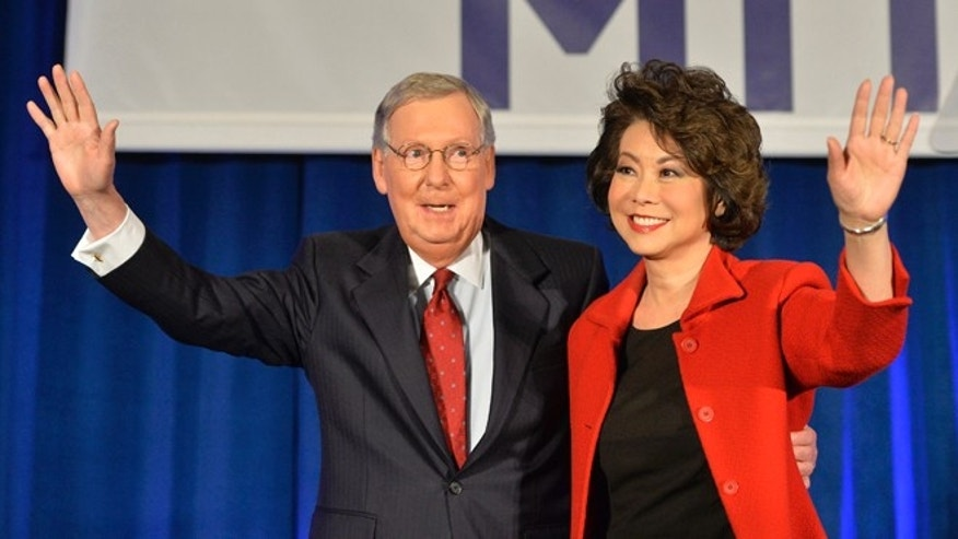 Senate Minority Leader Mitch McConnell of Ky. and his wife, former Secretary of Labor Elaine Chao, wave to a gathering of supporters at his victory celebration in Louisville, Ky., Tuesday, Nov. 4, 2014. (AP Photo/Timothy D. Easley)
