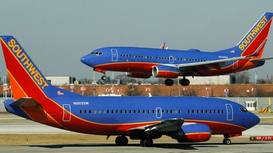 Feb. 9, 2012: A Southwest Airlines Boeing 737 waits to take off at Chicago's Midway Airport as another lands.