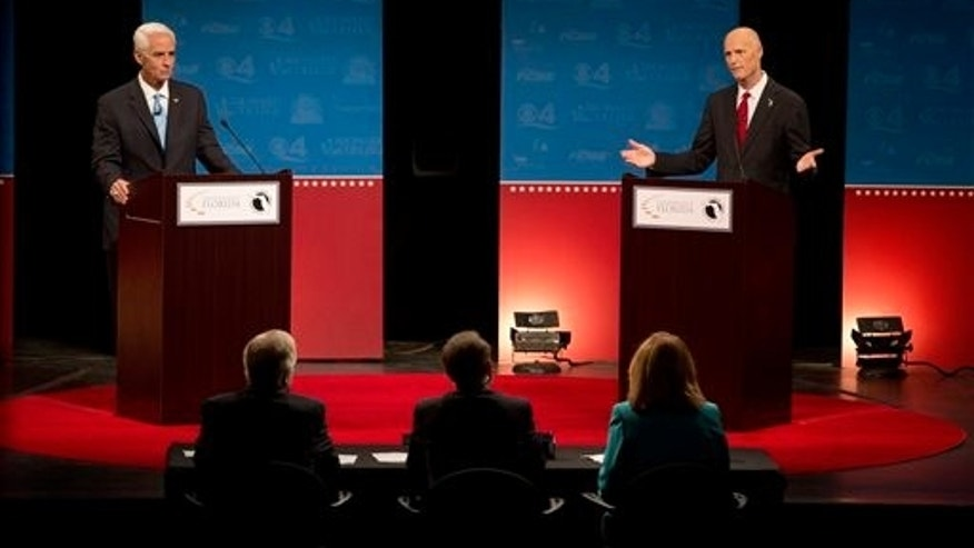Oct. 15, 2014: Democratic challenger, former Republican Gov. Charlie Crist, left, and Florida Republican Gov. Rick Scott, answer questions during their second debate.