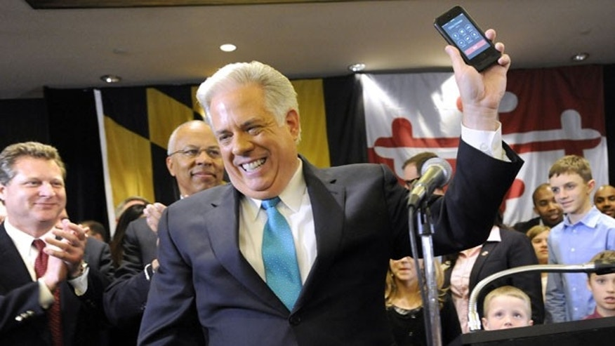 Nov. 5, 2014: Maryland Gov.-elect Larry Hogan, a Republican, gets a call from New Jersey GOP Gov. Chris Christie, Annapolis, Md.
