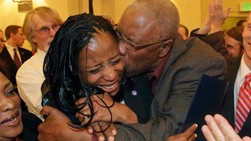 Nov. 4, 2014: Republican Mia Love celebrates with her father after winning the race for Utah's 4th Congressional District during the Utah State GOP election night watch party.