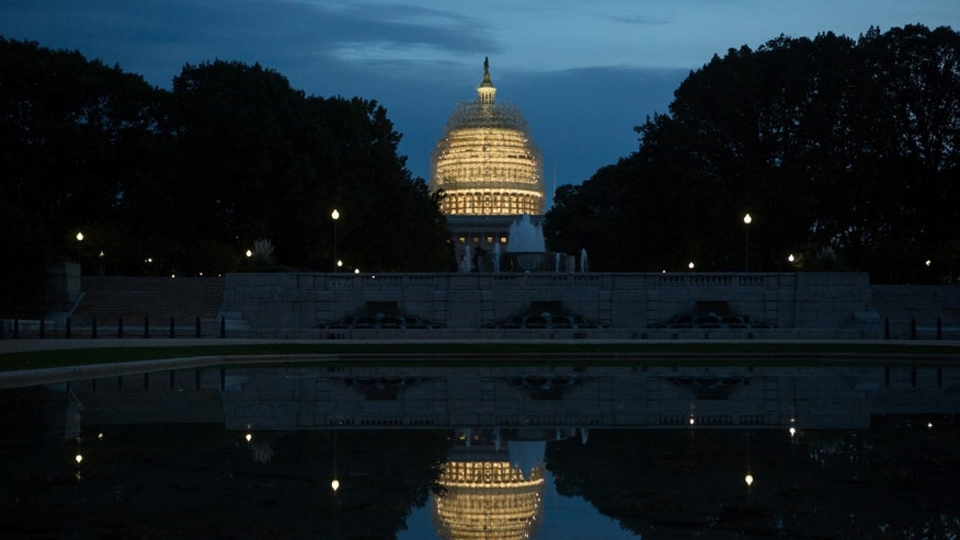 WASHINGTON, DC - NOVEMBER 4: Evening arrives at the Capitol building, covered in scaffolding for major repairs, on Capitol Hill in Washington D.C.  Today's elections will decide which party will lead the Senate.  (Photo by Allison Shelley/Getty Images)