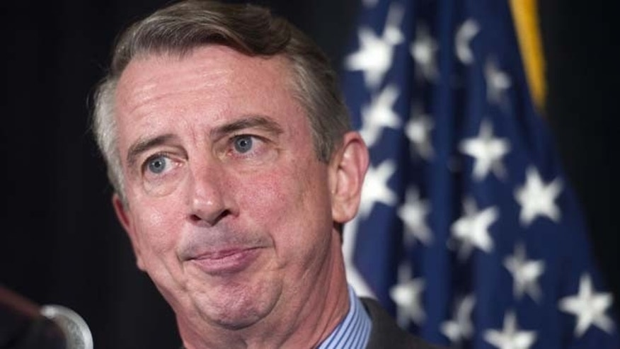 Virginia Republican Senate candidate Ed Gillespie concedes defeat in his Virginia Senate race against Democratic incumbent, Mark Warner, Friday, Nov. 7, 2014, during a news conference in Springfield, Va.