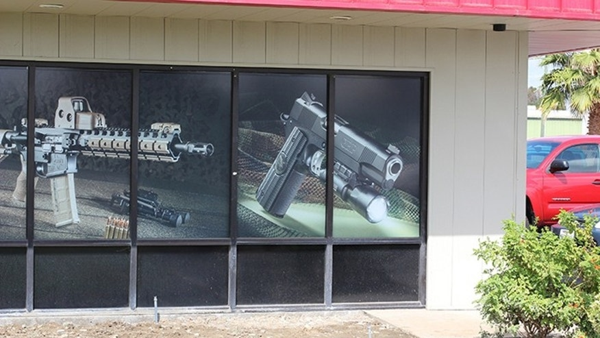 Michael Baryl, of Tracy Rifle & Pistol, has until February to take down this window display to comply with a Bureau of Firearms order. (Photo: Tracy Rifle and Pistol)