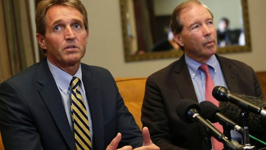 Nov. 11, 2014: U.S. Republican Senator Jeff Flake speaks to reporters as U.S. Democrat Senator Tom Udall listens during a news conference in Havana. (Reuters)