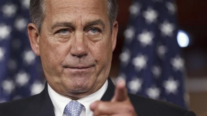 FILE: House Speaker John Boehner takes questions during a news conference on Capitol Hill, in Washington, D.C.