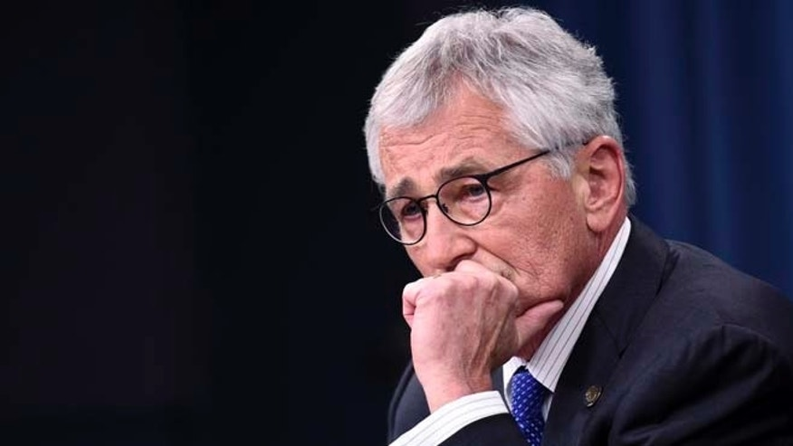 In this Thursday, Oct. 30, 2014, file photo, Defense Secretary Chuck Hagel listens to a question during a briefing at the Pentagon.