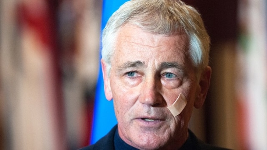 November 14, 2014: Secretary of Defense Chuck Hagel addresses the media at the Airman's Event during his visit to Minot Air Force Base, N.D. (AP Photo/Kevin Cederstrom)