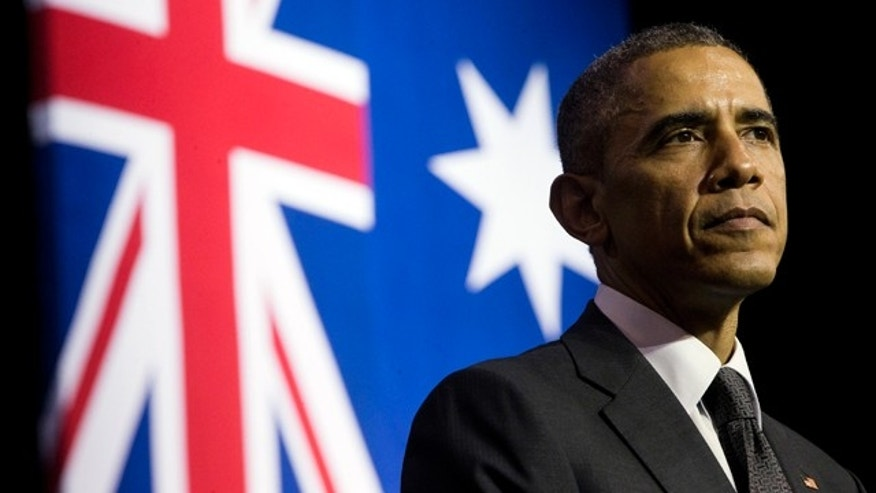 November 15, 2014: U.S. President Barack Obama pauses during his speech at the University of Queensland in Brisbane, Australia. (AP Photo/Pablo Martinez Monsivais)