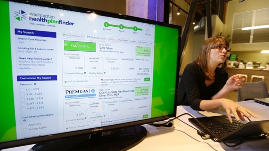 FILE - In this Sept. 30, 2013 file photo, Nelly Kinsella demonstrates the Washington Healthplanfinder website, in Seattle (AP Photo/Elaine Thompson, File)