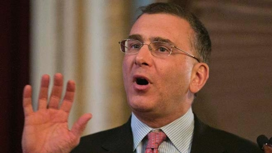 In this March 12, 2014 photo, Economist Jonathan Gruber speaks at a conference in Boston, Mass.