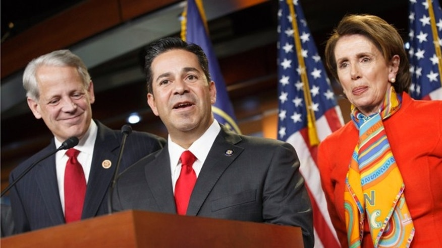 Rep. Ben Ray Lujan, D-N.M., center, thanks House Minority Leader Nancy Pelosi, D-Calif., right, after she announced he will take over as head of the Democratic Congressional Campaign Committee from Rep. Steve Israel, D-N.Y., left, during a news conference at the Capitol in Washington, Monday, Nov. 17, 2014.