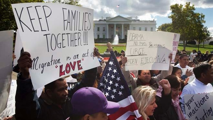 In this Nov. 7, 2014 file photo, people rally for comprehensive immigration reform outside the White House in Washington.