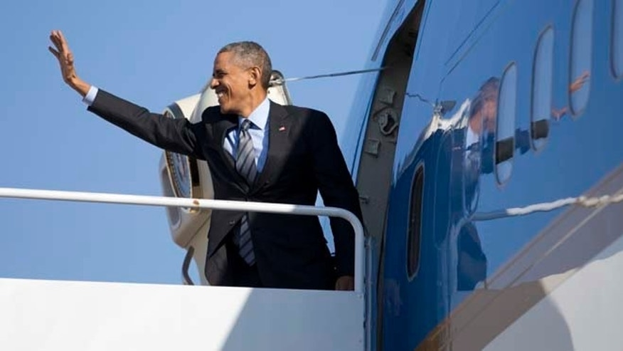 In this Friday, Nov. 21, 2014 photo, President Barack Obama boards Air Force One at Andrews Air Force Base, Md., en route to Las Vegas, where he will speak at Del Sol High School about the steps he will be taking on immigration.