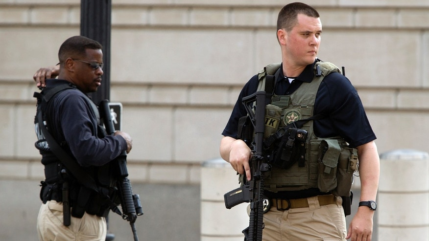 June 28, 2014: U.S. Federal Marshals secure the streets outside the U.S. federal court in Washington