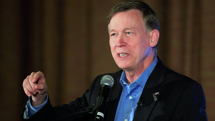 WESTMINSTER, CO - OCTOBER 14:  Colorado Gov. John Hickenlooper (D-CO) addresses the audience at the Colorado Energy Forum presented by the Consumer Energy Alliance on October 14, 2014 in Westminster, Colorado. Colorado Gubernatorial canditates Gov. John Hickenlooper (D-CO) and Republican candidate Bob Beauprez along with U.S. Sen. candidates Sen. Mark Udall (D-CO) and U.S. Rep. Cory Gardener (R-CO) deliver their views on the future of the Colorado energy economy, and participate in a question and answer session.  (Photo by Doug Pensinger/Getty Images)