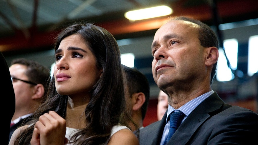Actress Diane Guerrero and Rep. Gutierrez listen as President Obama speaks about immigration at Del Sol High School, in Las Vegas, Nov. 21, 2014.