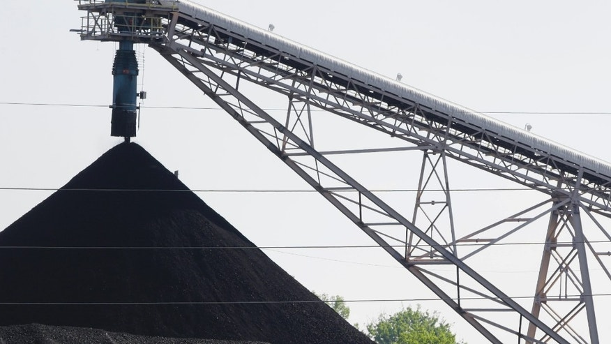 June 2, 2014: A hill of coal is seen at the North Omaha Station, a coal-burning power station, in Omaha, Neb.