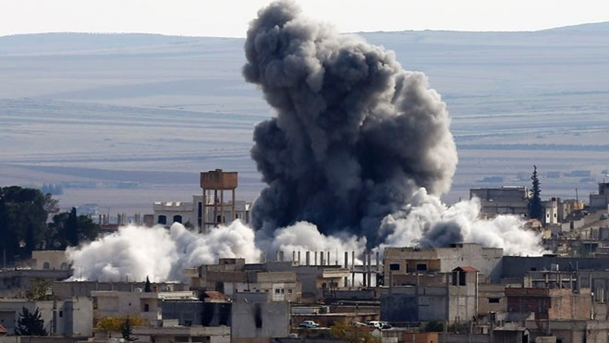 Nov. 23, 2014: An explosion following an air strike is seen in Kobani, Syria, near the Turkish border.