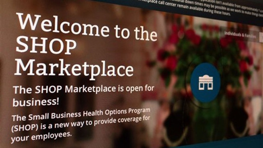 November 27, 2013: This photo shows part of the HealthCare.gov website page featuring information about the SHOP Marketplace is photographed in Washington. (AP Photo/Jon Elswick)