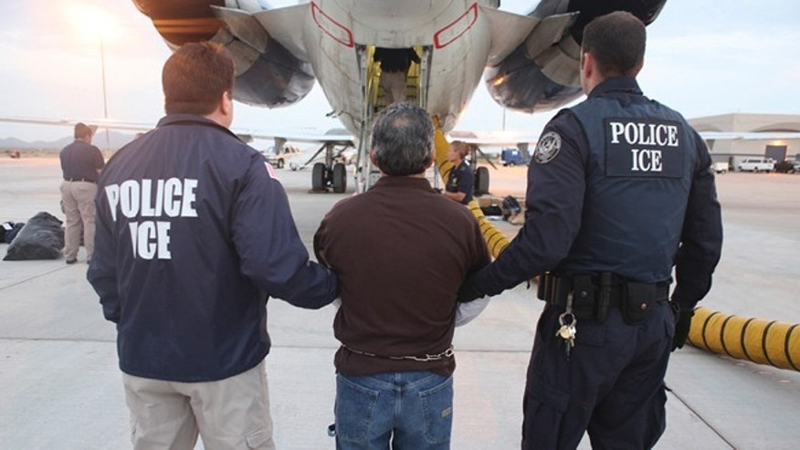 This file photo shows U.S. Immigration and Customs Enforcement (ICE) officials.