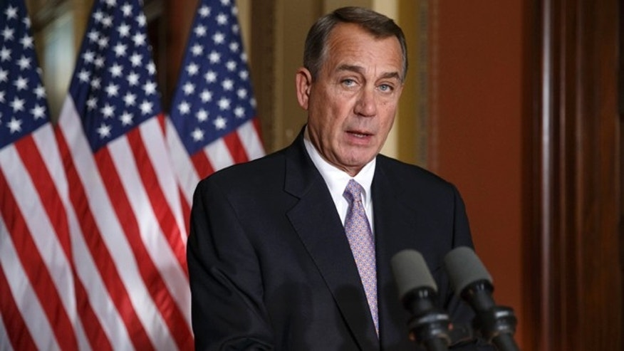 In this Nov. 21, 2014 file photo, House Speaker John Boehner of Ohio responds to President Barack Obama's intention to spare millions of illegal immigrants from being deported during a news conference on Capitol Hill in Washington.