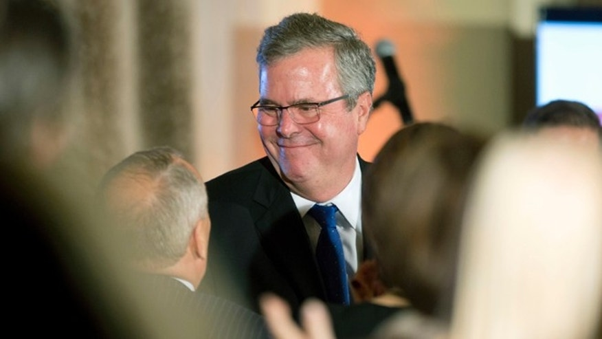 Former Florida Gov. Jeb Bush talks to supporters after speaking at the U.S. Cuba Democracy PAC's 11th Annual Luncheon in Coral Gables, Fla., Tuesday, Dec. 2, 2014. As governor of Florida, Bush oversaw a diverse state that is home to three-quarters of the nation's estimated 2 million Cuban-Americans. His longstanding support for the U.S. trade embargo against Cuba would provide a marked contrast with Democrat Hillary Clinton in 2016, if both decide to run for president. (AP Photo/J Pat Carter)